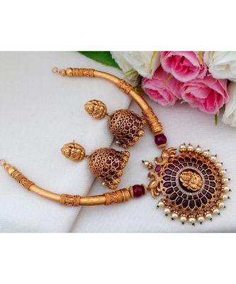 Gorgeous Matt Gold Finish Trunk Design Necklace with Real Kemp Stone Lakshmi Pendant  and Matching Jhumkas