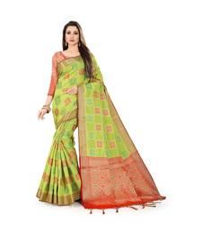Buy Mehendi Green coloured weaved banarasi silk saree with tassels and contrast blouse