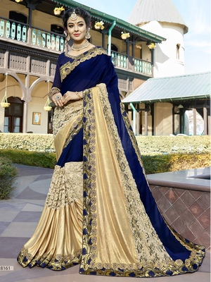 Blue and golden embroidered georgette saree with blouse