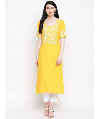 Yellow cotton rayon chikankari kurti with white cotton trousers
