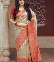 Beige woven banarasi silk saree with blouse