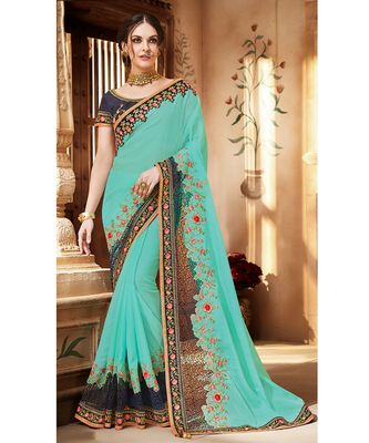 Sky Blue Silk Georgette Saree having Fancy Fabric attachment with Navy Blue Border and Blouse