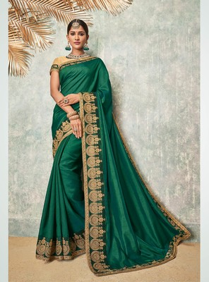 Dark green embroidered art silk saree with blouse