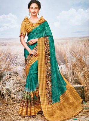 Turquoise printed pure georgette saree with blouse