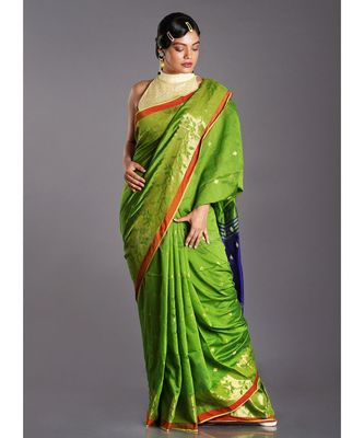 green blended cotton saree with blue pallu and golden motifs