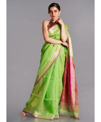 green linen saree with polka dots and pink pallu