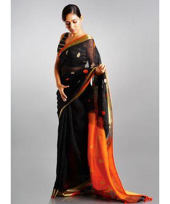 black linen saree with polka dots and orange pallu