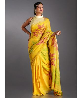 yellow linen saree with red and green motifs