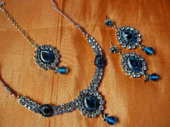 bridal collection turquoise stone and diamond studded set with matching earrings and maang teks