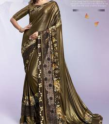 Golden embroidered lycra saree with blouse