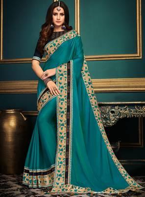 Dark blue embroidered silk saree with blouse