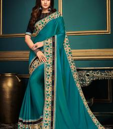 Dark blue embroidered silk saree with blouse