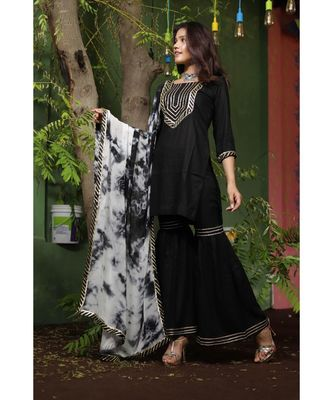 Black and white sharara suit set.