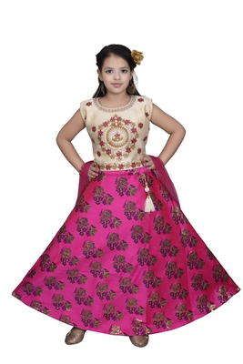 MAGENTA PINK FLORAL BROCADE LEHENGA WITH CREAM EMBROIDERED CHOLI AND PINK NET DUPATTA