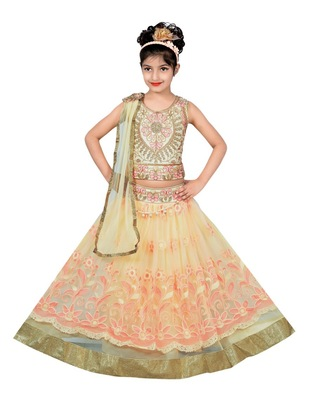 CREAM AND PEACH NET EMBROIDERED LEHENGA WITH EMBROIDERED CHOLI AND ATTACHED NET DUPATTA