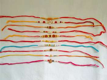 Assorted Ethnic Rakhi Set in Different Designs and Colors for Brother with a pack of Roli Chaval Set of 10 Rakhi