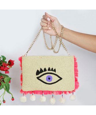 Creme Evil Eye Sling Bag