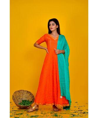 orange bandhani dress with green dupatta
