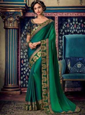 Dark parrot green woven silk saree with blouse