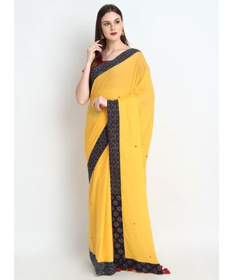 Yellow Cotton Malmal Saree With Hand Embroidered Mirror & Multiple Design Ajrakh Border & Fancy Tessels on Pallu