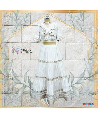 This gorgeous set of crop top and skirt has rose gold and off white coloured imported