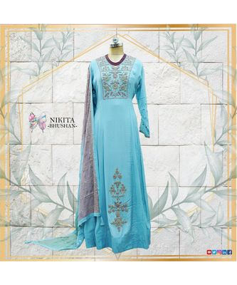 A long Anarkali dress with authentic handwork and embroidered tri-colour dupatta.