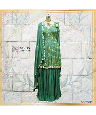This beautiful sharara suit with peplum top is made with fusion of print and handwork of pitta, sippi and nalki