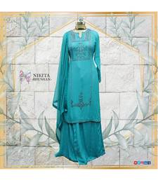 The gorgeous dress is made in a eautiful shade of blue on chinon cloth