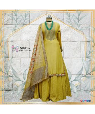 The gorgeous dress is made on chanderi with antique handwork on the kurta and chanderi skirt.