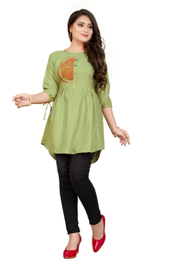 Green printed linen tunics