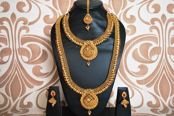 Red stone studded bridal necklace sets