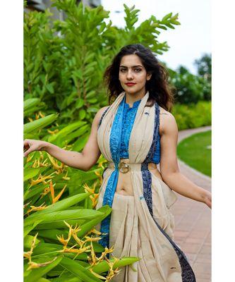 Stunning khadi cotton saree in timeless combination of cream body, azure border & delicate flamingo motifs