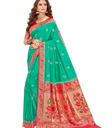 Sea green woven silk saree with blouse