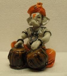 Ganpati Playing Tabla