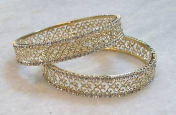Bollywood style plain gold & stone studded pair of bangles