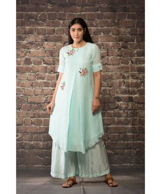 sulochana jangir ice blue handloom linen twillkurta with 3 flower hand embroidery paired with maching pants.