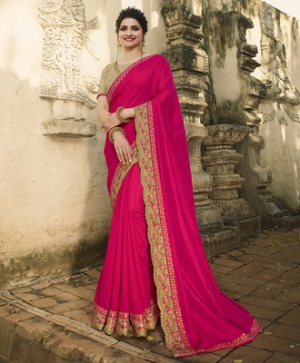 Dark pink embroidered raw silk saree with blouse