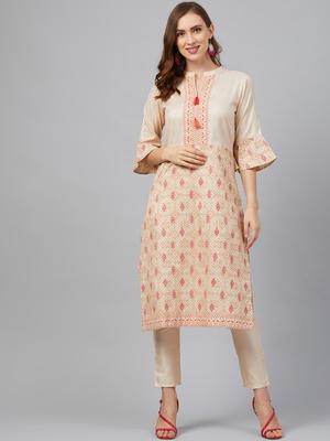Cream printed art silk kurta set