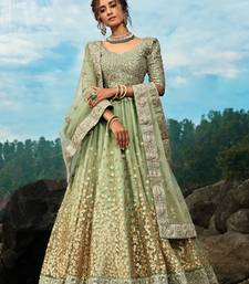 Green sequins net semi stitched lehenga