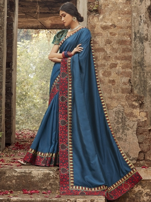 Teal embroidered dupion silk saree with blouse