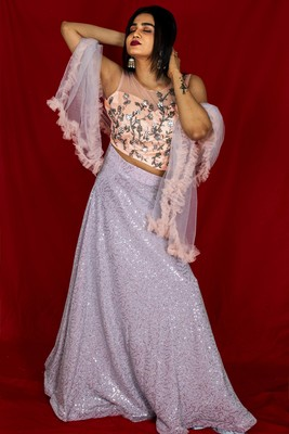 Silver Grey Sequin Lehenga with peach embroidered blouse with ruffle dupatta