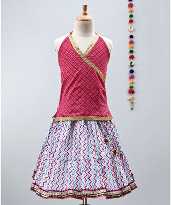 Pink and Blue cotton zigzag lehenga with  halter neck choli and golden lace
