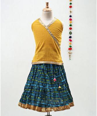 Green and Yellow cotton Lehenga with a Halter neck choli and a golden lace