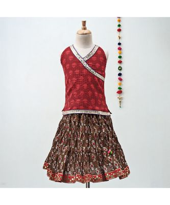 mahroon and red cotton Lehenga with a self print contrast halter neck choli and gota patti lace