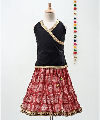 red and black cotton printed lehenga with a contrast choli and a golden lace