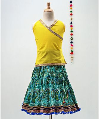 green and yellow cotton lehenga with a contrast  halter neck choli and a golden lace