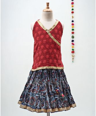 blue and red cotton printed lehenga with a contrast self print halter neck choli and a gold lace