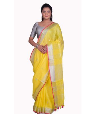 Handcrafted Yellow Linen saree with Silver zari border and beautiful embroidery work