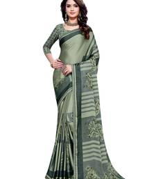Teal printed shimmer saree with blouse
