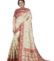 Cream embroidered tissue saree with blouse